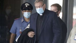 Australian Cardinal George Pell arrives at Rome's international airport in Fiumicino. (Photo / AP)