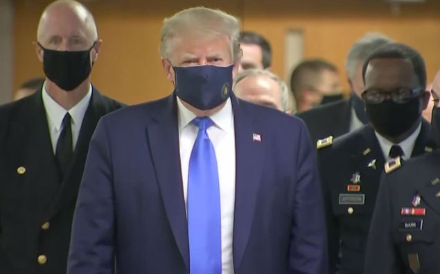 Donald Trump wearing a face mask during an earlier visit to the hospital. (Photo / Pool)