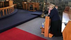 Judith Collins was photographed praying yesterday. (Photo / NZ Herald)