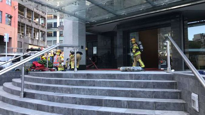 Fire and Emergency personnel at a 12-storey building on Fanshawe St, Auckland. Photo / Lane Nichols