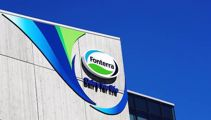 Fonterra sells China farms for $555m to pay down debt