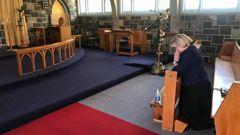 National leader Judith Collins prays. (Photo / NZ Herald)