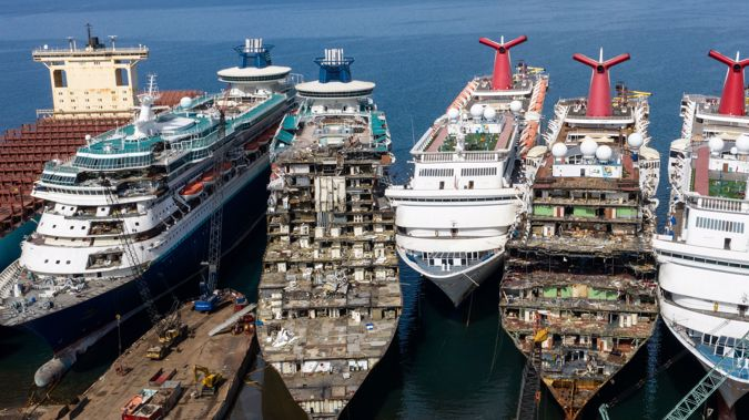 Cruise ships that once ferryed passengers on vacations around the world, now lie ready to be sold for scrap. (Photo / Getty)
