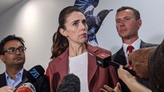 Prime Minister Jacinda Ardern talks to media flanked by Labour party candidates Dr Gaurav Sharma for Hamilton West (left) and Jamie Strange for Hamilton East. (Photo / Amelia Wade)