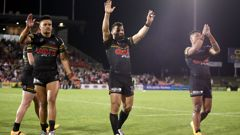 Pantehrs players celebrate their win over the Roosters in finals week one. (Photo / Getty)