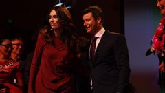 Labour leader and Prime Minister Jacinda Ardern celebrate with partner Clarke Gayford. (Photo / Supplied)