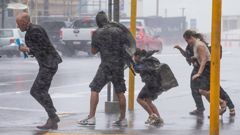 Pedestrians battle wild weather delivered with the remnants of Cyclone Fehi in February 2018. That cyclone season is being compared to the coming one. Photo / Mark Mitchell