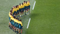 Wallabies players during the national anthem. (Photo / Getty)