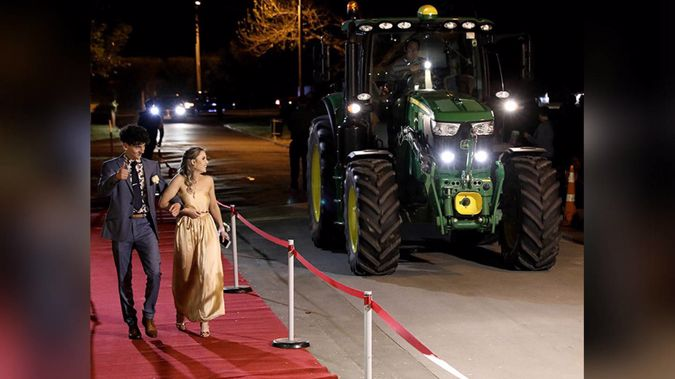 Tom Williams and his ball partner Olivia Horsbrugh made a splash after arriving to their Wairarapa College school ball in a tractor. Photo / Supplied