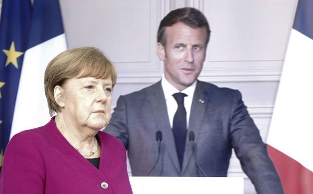 Angela Merkel and Emannuel Merkel. (Photo / AP)