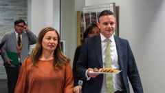 Green Party co-leaders Marama Davidson and James Shaw bringing a plate of biscuits for the waiting media scrum after their talks with the Labour Party leadership. Photo / Mark Mitchell