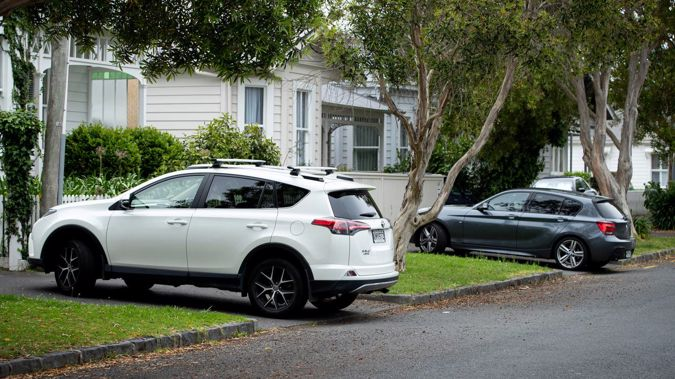 Cars parked over footpaths in central Auckland. Photo / Dean Purcell.
