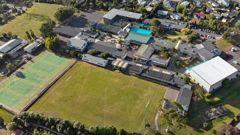 A mother has allegedley assaulted a boy at Glen Eden Intermediate School (above). Photo / Supplied