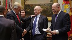 Donald Trump's Kiwi deputy chief of staff Chris Liddell (middle) had been nominated by the US to be head of the OECD. (Photo / Getty)