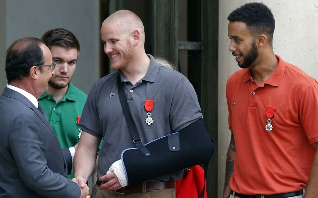 In this Aug. 24, 2015 file photo, French President Francois Hollande bids farewell to U.S. Airman Spencer Stone as U.S. National Guardsman Alek Skarlatos of Roseburg, Ore., second from left, and Anthony Sadler, right, after Hollande awarded them the French Legion of Honor at the Elysee Palace in Paris.