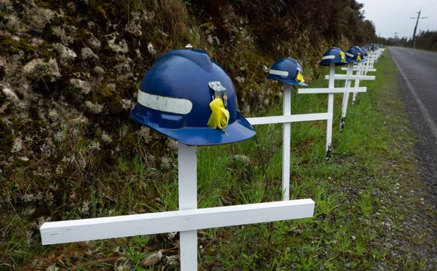 29 crosses with mine helmets on the road which leads to the Pike River Mine portal. Photo / Brett Phibbs