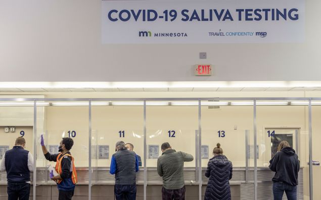 People get tested at the new saliva COVID-19 testing site at the Minneapolis-St. Paul International Airport.