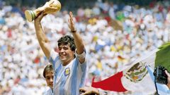 Diego Maradona of Argentina holds the World Cup trophy after defeating West Germany 3-2 during the 1986 FIFA World Cup Final in Mexico. Photo / Getty