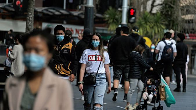 Aucklanders have been required to wear masks on public transport for the past week. Photo / Alex Burton