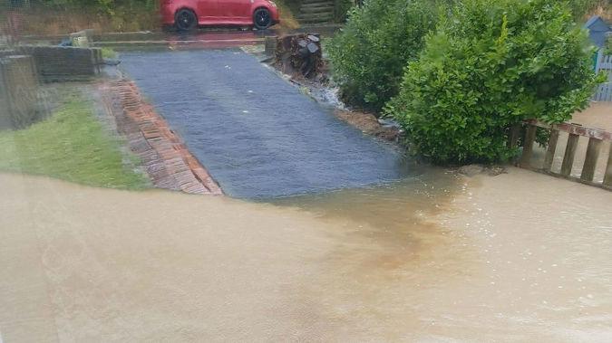 Hazel Kale's driveway flooded in the heavy rain. Photo / Supplied