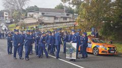 The family of slain policeman Matthew Hunt and colleagues marched to remember him near where he was shot dead. Photo / NZ Herald