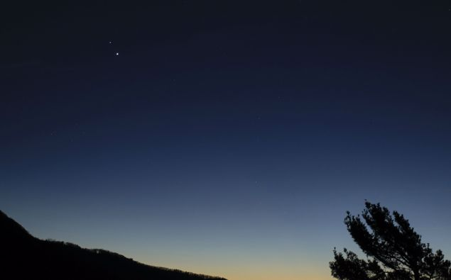 In this Sunday, Dec. 13, 2020 photo made available by NASA, Saturn, top, and Jupiter, below, are seen after sunset from Shenandoah National Park in Luray, Va.  (Photo / via AP)