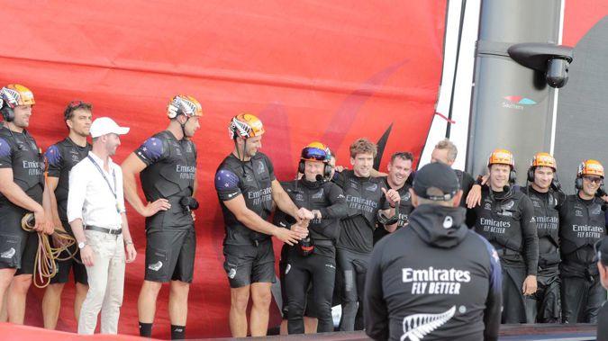 Emirates Team New Zealand crew celebrate beating Luna Rossa Prada Pirelli in rac 3 on day three of the ACWS America's Cup World Series Christmas Regatta. Photo / Michael Craig.