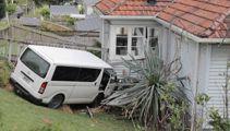 Van hits pedestrian before crashing into house