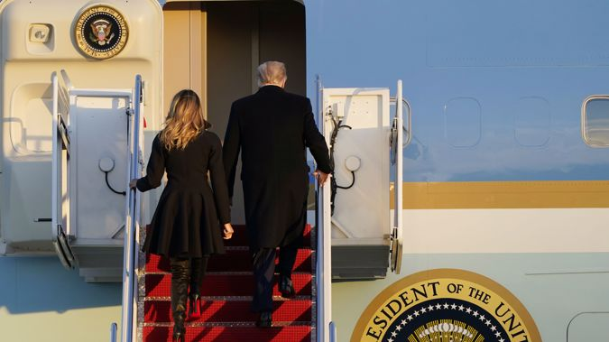 President Donald Trump and first lady Melania Trump, board Air Force One on way to the Mar-a-Lago resort.