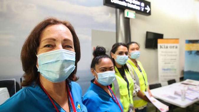 Health officials at Auckland International Airport. (Photo / NZ Herald)