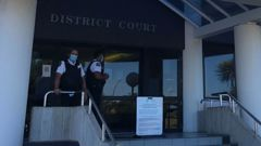 Security guards outside the Hamilton District Court. (Photo / Belinda Feek)