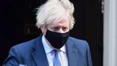 Britain's Prime Minister Boris Johnson leaves 10 Downing Street, bound for the House of Commons where lawmakers are to vote on restrictions imposed in England's third national lockdown. (Photo / AP)