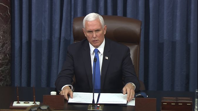 Mike Pence speaks as the Senate reconvenes after protesters stormed into the U.S. Capitol