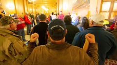 Supporters of President Donald Trump gather inside the Kansas Statehouse. (Photo / AP)