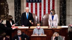 Vice-President Mike Pence and Speaker of the House Nancy Pelosi officiate as a joint session of the House and Senate reconvenes to confirm the Electoral College votes at the Capitol. Photo / AP