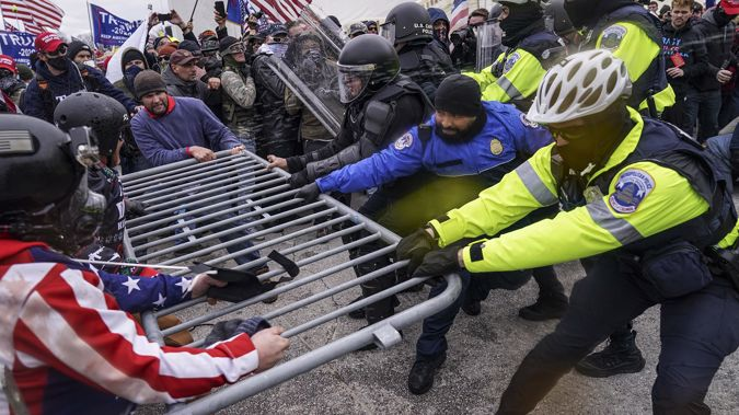 Supporters of President Donald Trump try to break through a police barrier at the US Capitol. Photo / CNN