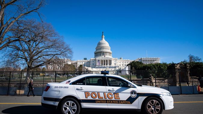 A US Capitol Police car drives past on patrol in front of security fencing near the West Front of the U.S. Capitol. (Photo / CNN)