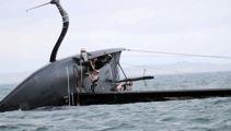 Watch: American Magic dramatically capsize during Prada Cup racing