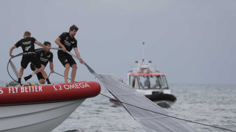 Team New Zealand rush to help competitors American Magic after capsize