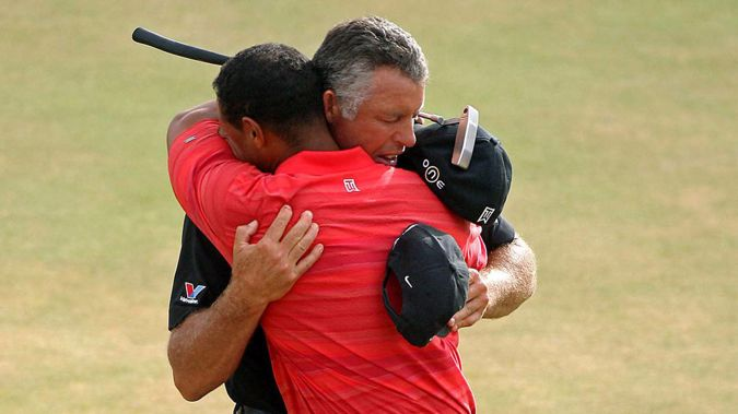 Tiger Woods embraces his caddy Steve Williams after his victory in 2006. Photo / Photosport