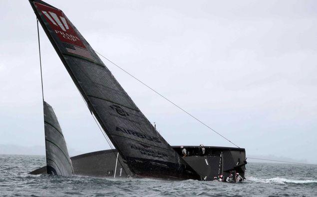 American Magic capsizes and nearly sinks. Photo / Michael Craig