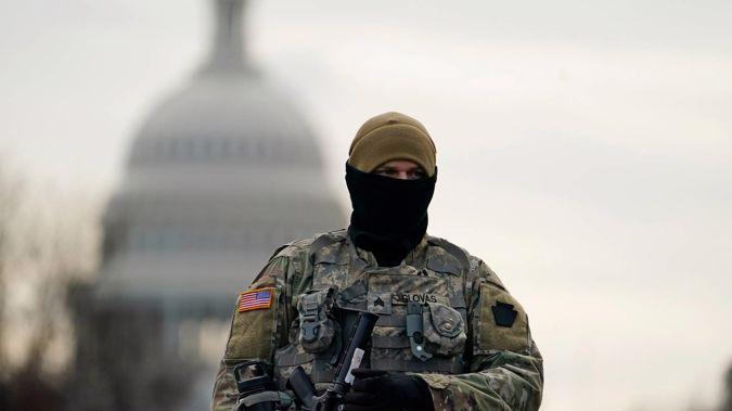 A National Guard soldier stands at a roadblock outside the Capitol in Washington DC as security is ramped ahead of US President-elect Joe Biden's inauguration ceremony. Photo / AP