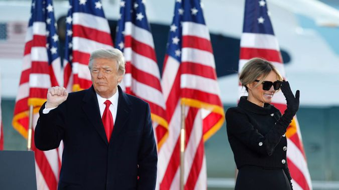 President Donald Trump and first lady Melania Trump wave to supporters after giving a speech at Andrews Air Force Base. Photo / AP