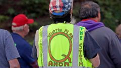 n this May 14, 2020, file photo, a person wears a vest supporting QAnon at a protest rally in Olympia, Washington. (Photo / AP)
