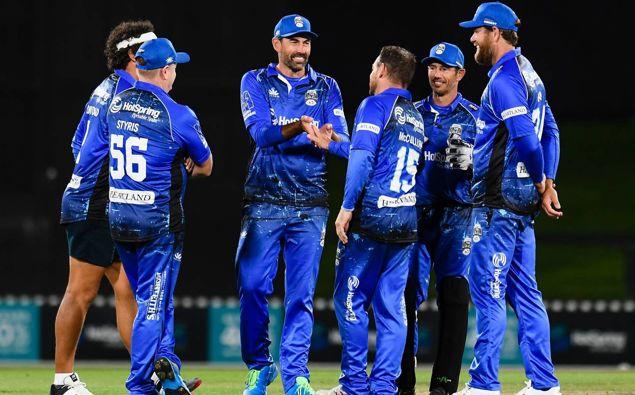 Team Cricket celebrates a wicket during the Black Clash. Photo / Photosport
