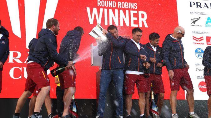 Ineos Team UK members celebrate winning the round robin stage of the Prada Cup. Photo / Brett Phibbs