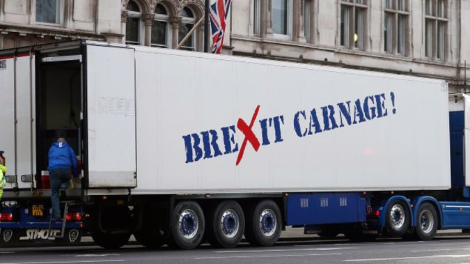 A policeman escorts the driver of a shellfish export truck as he is stopped for an unnecessary journey in London during a demonstration by British Shellfish exporters to protest Brexit-related red tape they claim is suffocating their business.(Photo / AP)