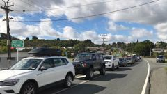 A queue of vehicles at the testing station in Kamo, north of Whangārei yesterday. Photo / Karina Cooper