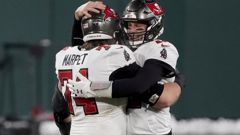 Tampa Bay Buccaneers quarterback Tom Brady (12) celebrates with Ali Marpet after winning the NFC championship NFL football game. Photo / AP