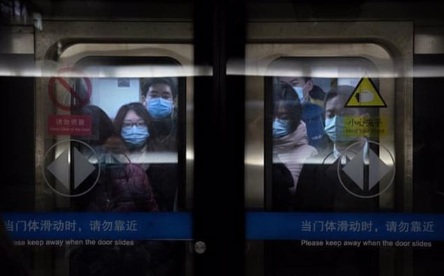Commuters in Beijing on Wednesday. Officials reportedly took anal swabs from residents of areas with confirmed Covid cases in the capital last week. Photo / AP